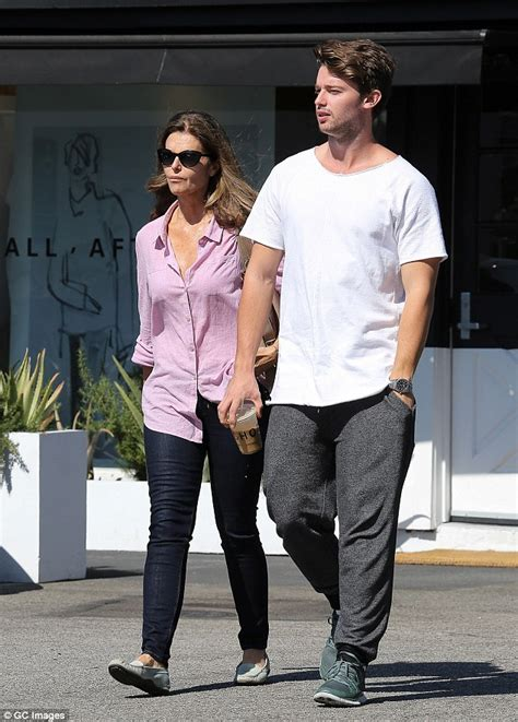 Patrick Schwarzenegger towers over his mother Maria
