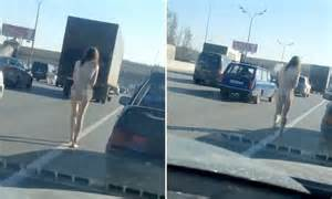 Russian video shows naked woman walking down middle of